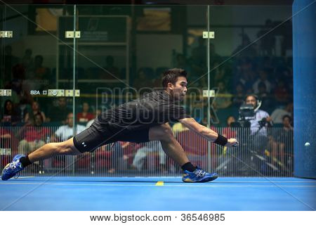 KUALA LUMPUR - SEPTEMBER 02: Nafiizwan Adnan stretches to return a shot in the men's finals of the Malaysian National Squash Championships played in Kuala Lumpur, Malaysia on September 02, 2012.