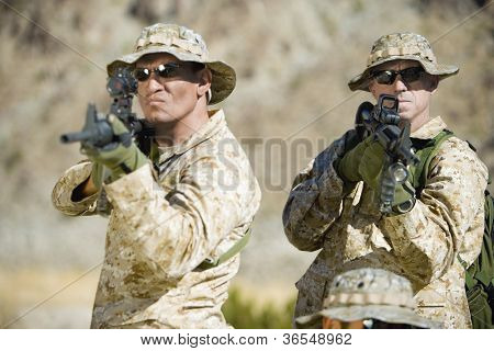 Soldiers with assault rifles on a mission