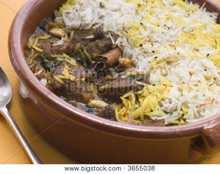 Pot Of Lamb Biryani With A Spoon