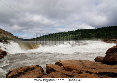 Wide Waterfall Under Cloudy Sky