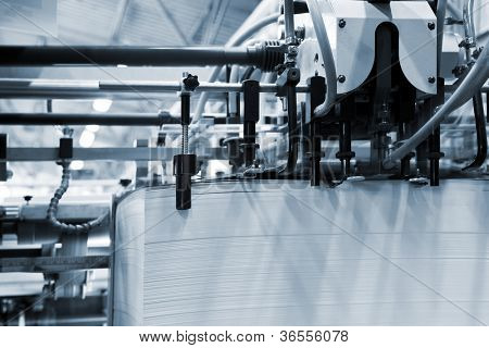 The equipment for a press in a modern printing house