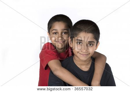 Indian brothers smiling happily against a white background