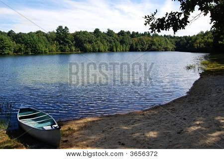 A Canoe By The Lake