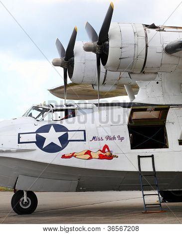"PILSEN, CZECH REPUBLIC - AUGUST 25: American sea plane Consolidated PBY-5A Catalina ""Miss Pick Up"" with retro nose art, Pilsen Aeronautical Days on August 25, 2012 in Pilsen Czech Republic."