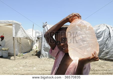 A boy carrying water.