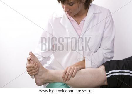 Physical Therapist Works On An Ankle