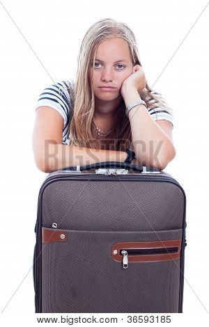 Bored Young Woman Traveling With Luggage