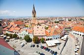 stock photo of mica  - Historical architecture Lutheran cathedral church and tower and other old buildings around Piata Mica  - JPG