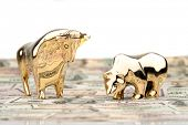 many dollar bills with bull and bear