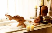 Photo of a woman relaxed at luxury spa salon, picture of young beautiful lady taking bath at home, i