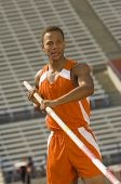 pic of pole-vault  - Male athlete preparing for pole vault - JPG