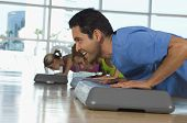 picture of step aerobics  - Man doing pushups on a step in aerobics class - JPG