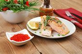 savory fish portion : roasted norwegian salmon chunks with  lemon and vegetable salad , rosemary twi