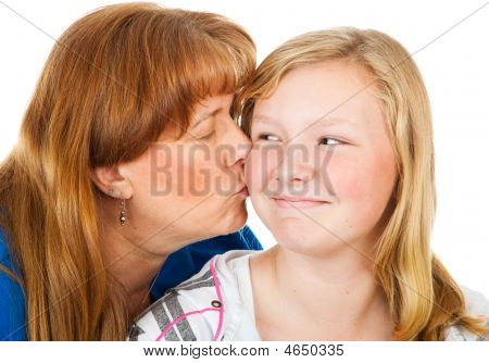 Mom Kisses Teen Daughter