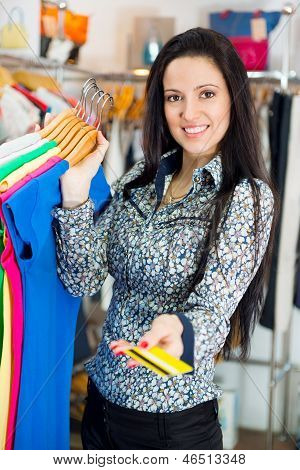 Smiling Young Girl Shopping With Credit Card