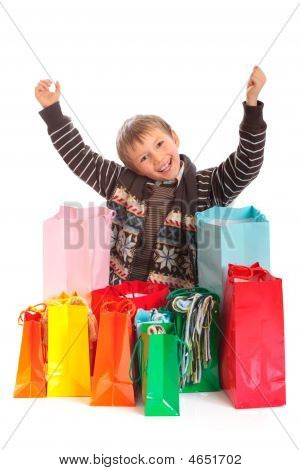 Happy Boy With Shopping Bags