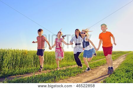 happy children shoot on field in summer time