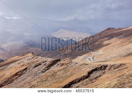 Road in Himalayas in clouds near Tanglang la Pass  - Himalayan mountain pass on the Leh-Manali highway. Ladakh, India
