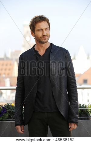 MUNICH, GERMANY - JUNE 07: Actor Gerard Butler poses during the 'Olympus Has Fallen - Die Welt in Gefahr' photocall at Hotel Mandarin Oriental on June 7, 2013 in Munich, Germany