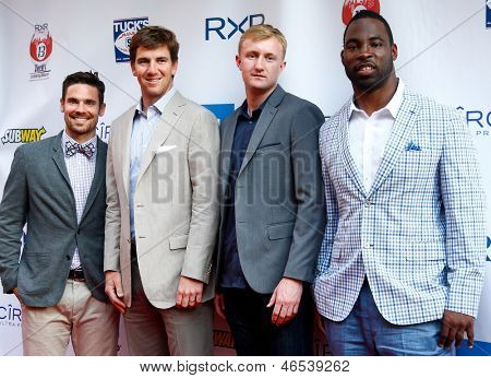 NEW YORK-MAY 30: (L to R) Heath Pearce, Eli Manning, Ryan Meara, and Justin Tuck attend the 5th annual Tuck's Celebrity Billiards Tournament at Slate NYC on May 30, 2013 in New York City.