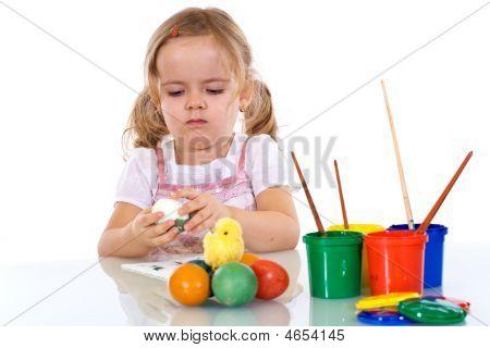 Little Girl Painting The Easter Eggs