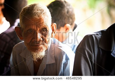 BERDUT, MALAYSIA - APR 8: Unidentified old man Orang Asli in his village on Apr 8, 2013 in Berdut, Malaysia. More than 76% of all Orang Asli live below the poverty line, life expectancy -53 years old.