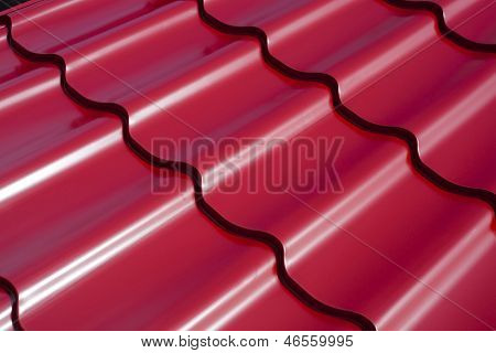 abstract pattern of red metal roof tiles
