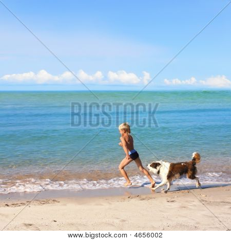 Photo Of Runing Boy And Dog On A Beach