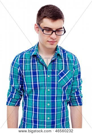 Pensive young man in black glasses and checkered shirt. Isolated on white background, mask included