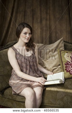 Young Woman With Beautiful Green Eyes Reading A Book.