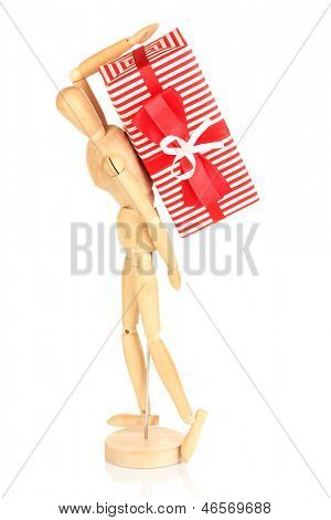 Wooden man carrying heavy gift isolated on white