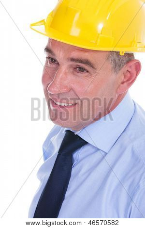 closeup portrait of a senior engineer with a helmet on his head, looking away from the camera and smiling. isolated on white background