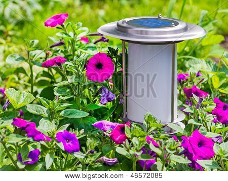 Solar-powered Garden Lamp On Flower Background.
