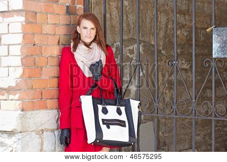 Attractive Woman Over Red Brick Wall