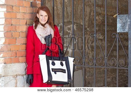 Attractive Smiling Woman Over Red Brick Wall
