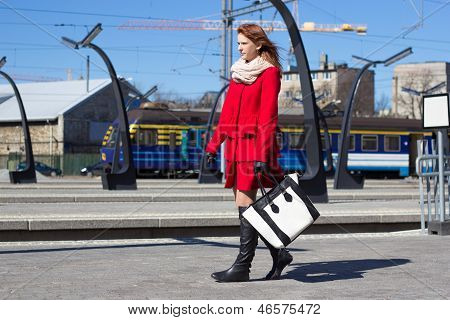 Young Woman At A Train Station