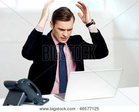 Disappointed Businessman Looking At Laptop