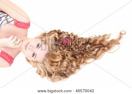 Young Beautiful  Woman With Long Curly Hair Lying