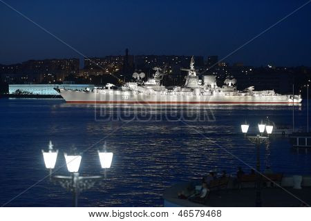 SEVASTOPOL, UKRAINE - MAY 8: Russian cruiser Kerch anchored in the bay before the military parade in honor of 230th anniversary of Black Sea Navy in Sevastopol, Crimea, Ukraine on May 8, 2013