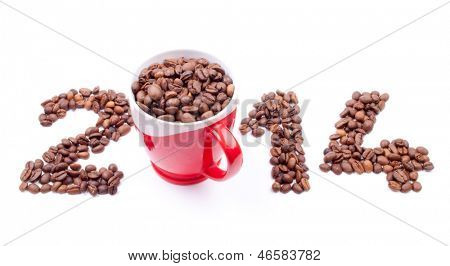 New Year 2014 made of coffee beans and cup on the white background