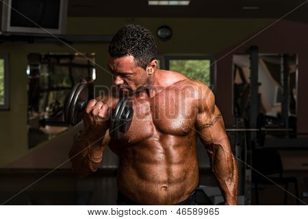 Bodybuilder Doing Heavy Weight Exercise For Biceps With Dumbbell