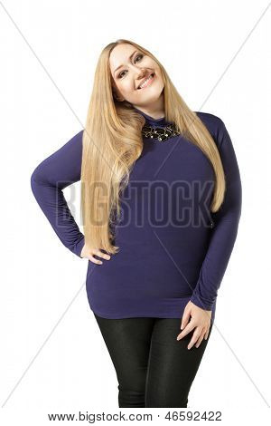 Charming xxl woman smiling and standing on white background