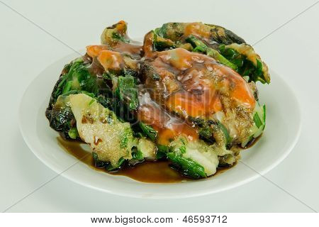 Fried cassava starch wrapped vegetable