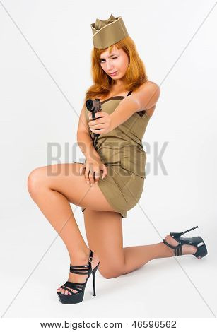 beautiful woman aiming in military uniform