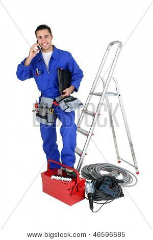 Electrician with tools and a telephone