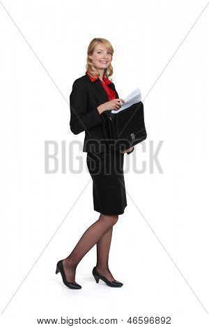 Businesswoman removing document from case