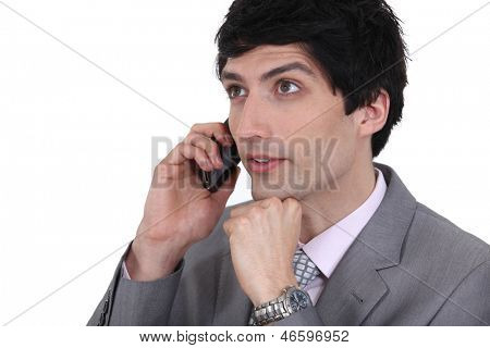 dishy businessman on phone with dreamy eyes