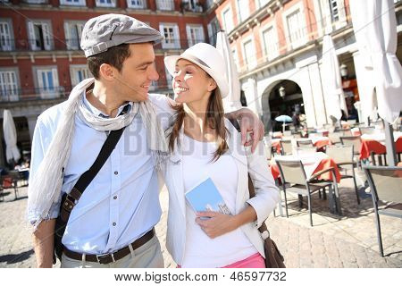 In love couple walking in the street of Eupopean capital