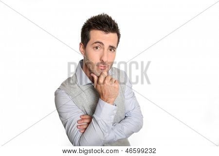 Man with hand on chin looking sceptical
