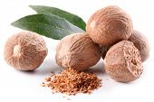 picture of ground nut  - Nutmeg with leaves on a white background - JPG